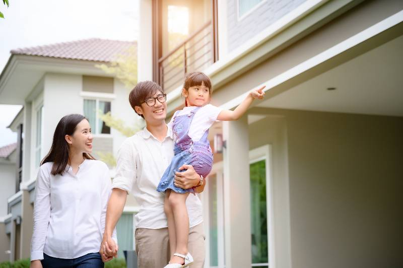family walking on the model new house looking for living life future